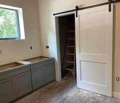kitchen and pantry with barn door